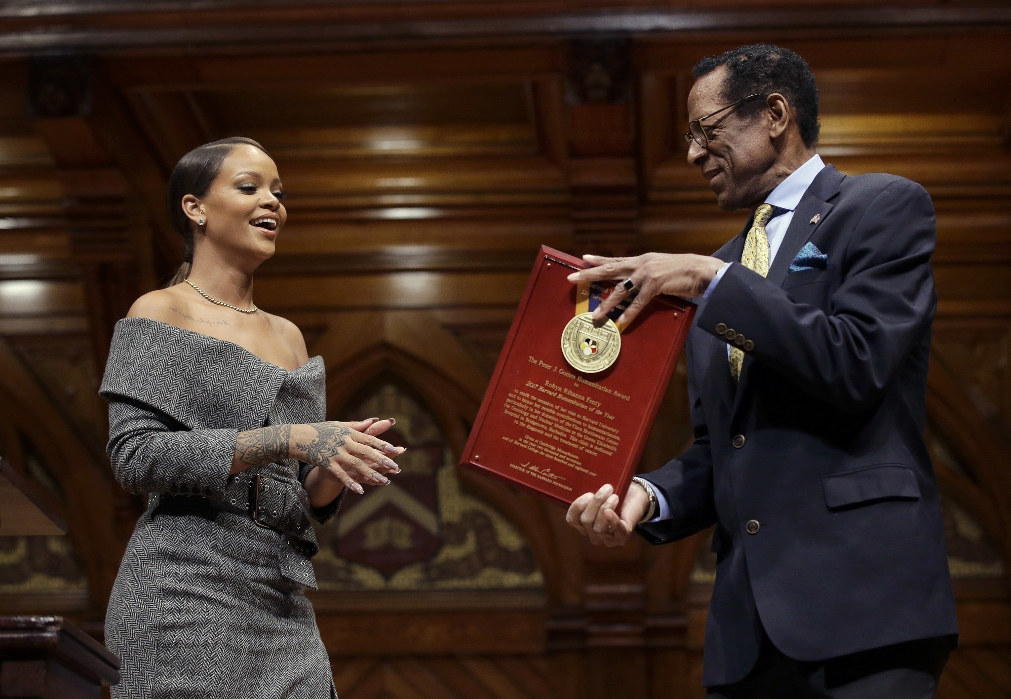 Rihanna is presented with the 2017 Harvard University Humanitarian of the Year Award by Allen Counter, director of the Harvard Foundation, Tuesday, Feb. 28, 2017. (AP Photo)