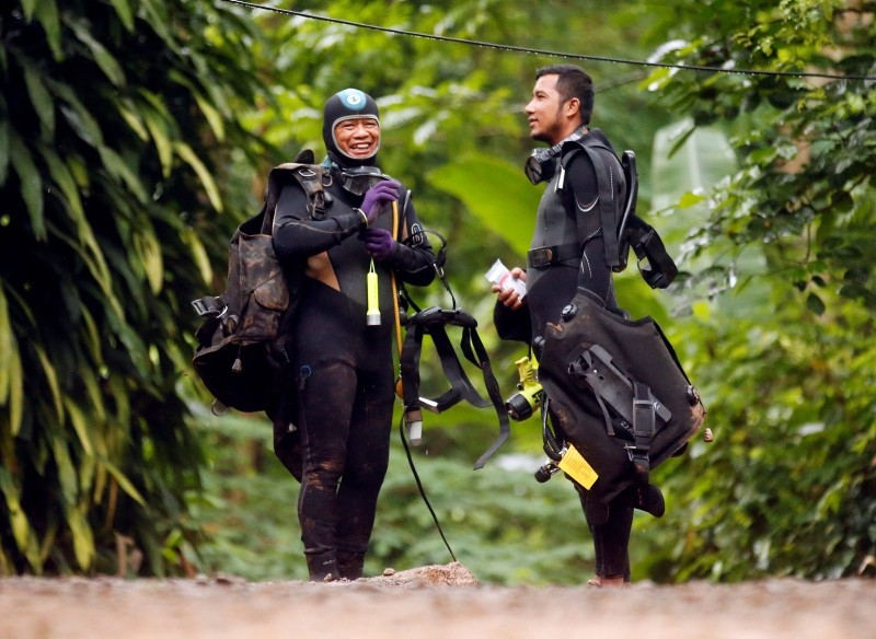 Thai rescuers prepare for diving after the 12 boys and their soccer coach were found alive, in Mae Sai, Chiang Rai province, in northern Thailand, Tuesday, July 3, 2018. (AP Photo)