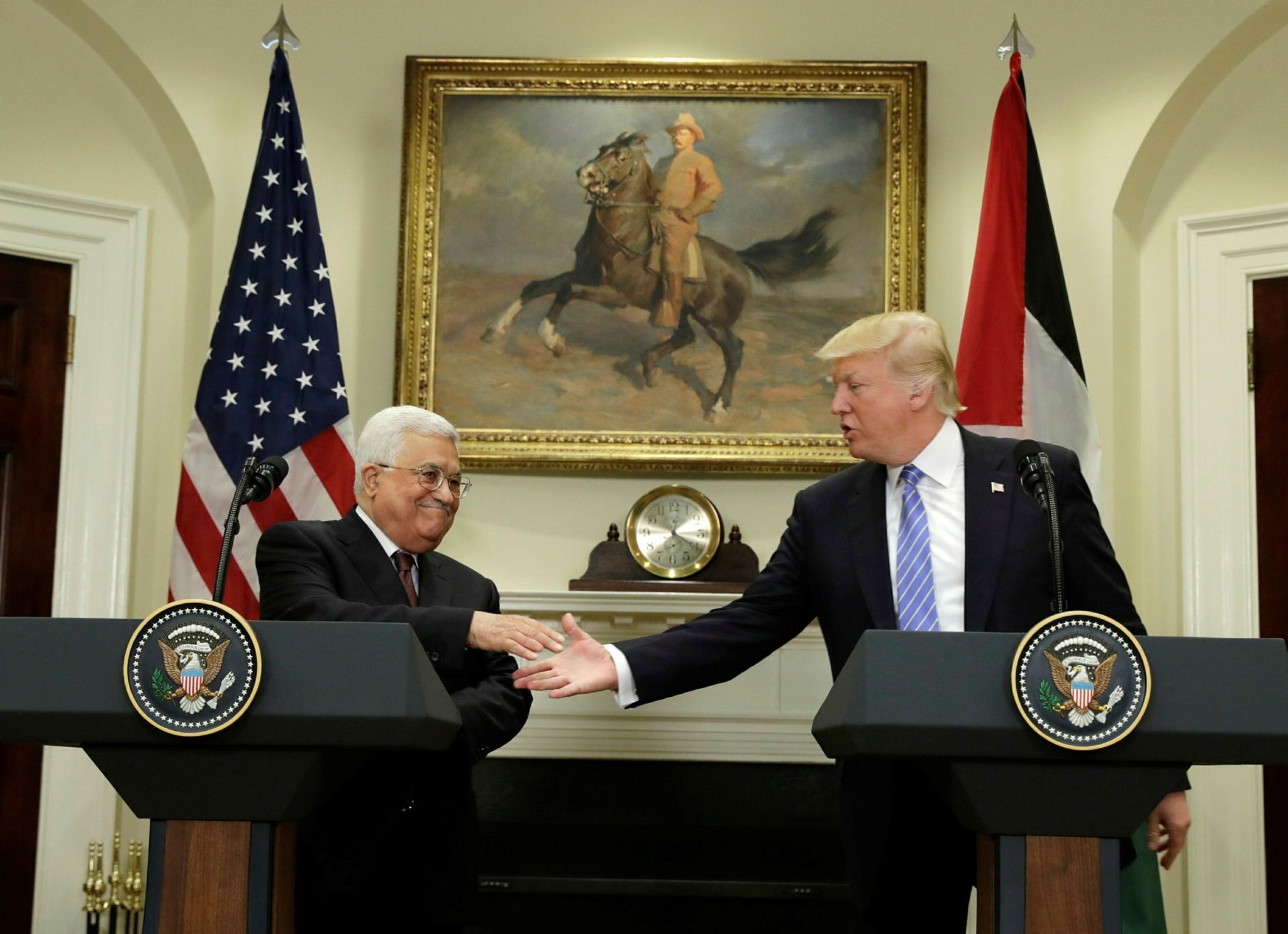 President Donald Trump shakes hands with his Palestinian counterpart Mahmoud Abbas during their news conference in the Roosevelt Room of the White House, Wednesday, May 3, 2017, in Washington. (AP Photo)
