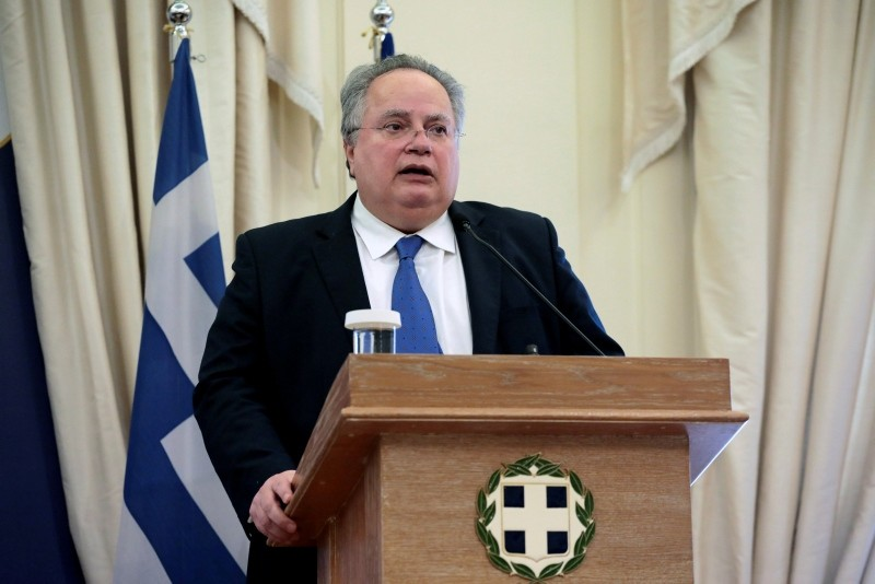 Greek Foreign Minister Nikos Kotzias addresses journalists during a joint press conference with his newly-appointed Greek Cypriot counterpart Nikos Christodoulides (not pictured) at the Foreign Ministry in Athens, March 5, 2018. (Reuters Photo)