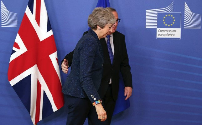 European Commission President Jean-Claude Juncker (L) arrives with British Prime Minister Theresa May before their meeting at the European Commission headquarters in Brussels, Thursday, Feb. 7, 2019.