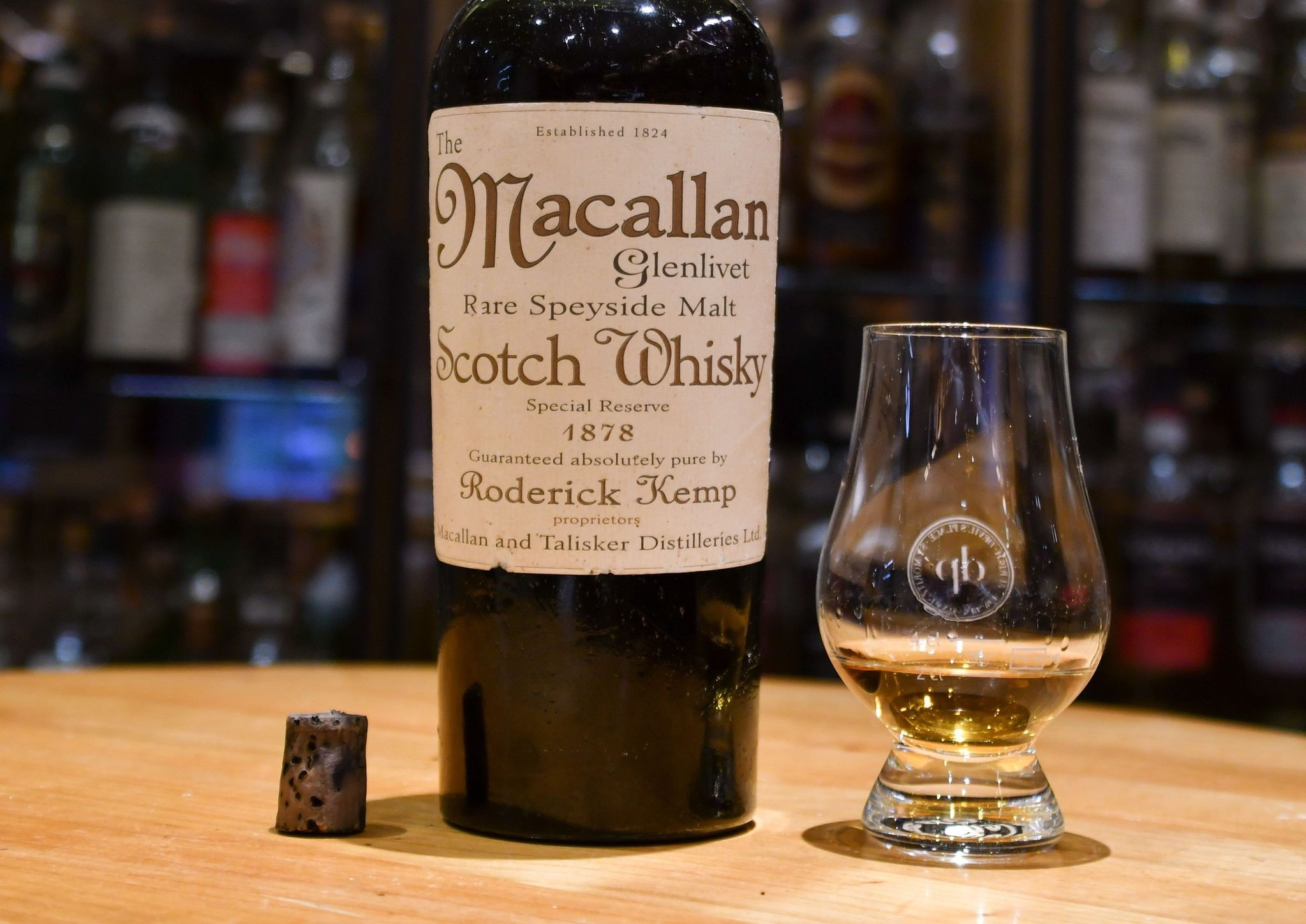 This file handout photo taken on August 2, 2017 by the Hotel Waldhaus am See in St. Moritz shows a bottle of whisky labeled to be made in 1878 by Scotch maker Macallan, at the hotel's Devil's Place Whisky Bar. (AFP Photo)