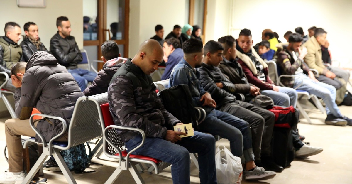 Illegal migrants wait at a migrant center they were taken to in Edirne, April 7, 2019.