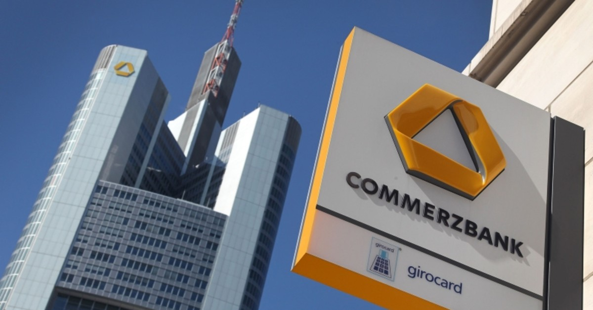This file photo taken on April 7, 2011 shows the logo of the Germany's second-largest lender Commerzbank on a branch (R) and the headquarters (L) of the bank in Frankfurt am Main (AFP Photo)