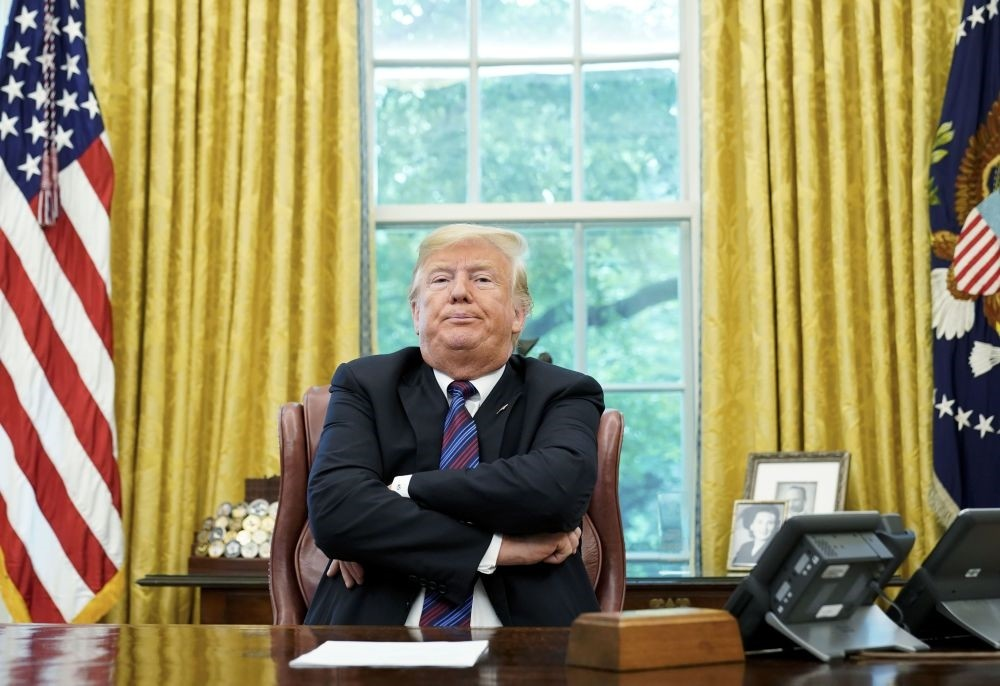 U.S. President Donald Trump speaks to reporters after a phone conversation with Mexico's President Enrique Pena Nieto on trade in the Oval Office of the White House in Washington, D.C., Aug. 27.