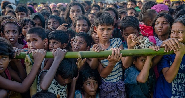 In this Sept. 25, 2017 file photo, Rohingya Muslim children, who crossed over from Myanmar into Bangladesh, wait to receive handouts near Balukhali refugee camp, Bangladesh. (AP Photo)