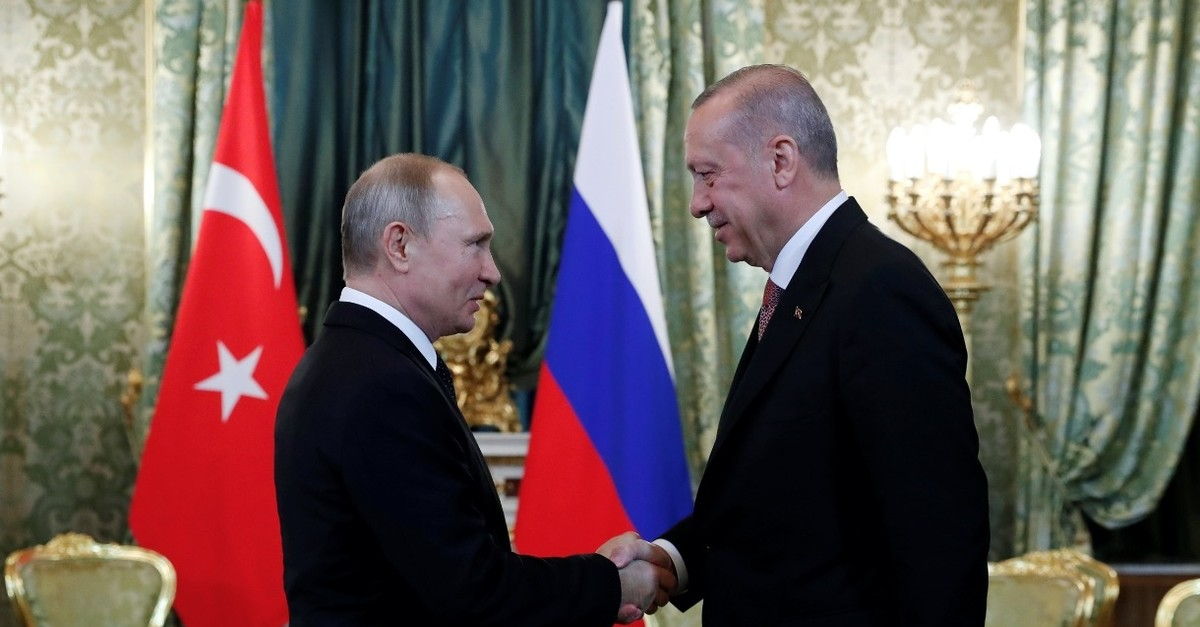 President Recep Tayyip Erdou011fan shakes hands with Russian President Vladimir Putin during a meeting in the Kremlin, Moscow, April 8, 2019.
