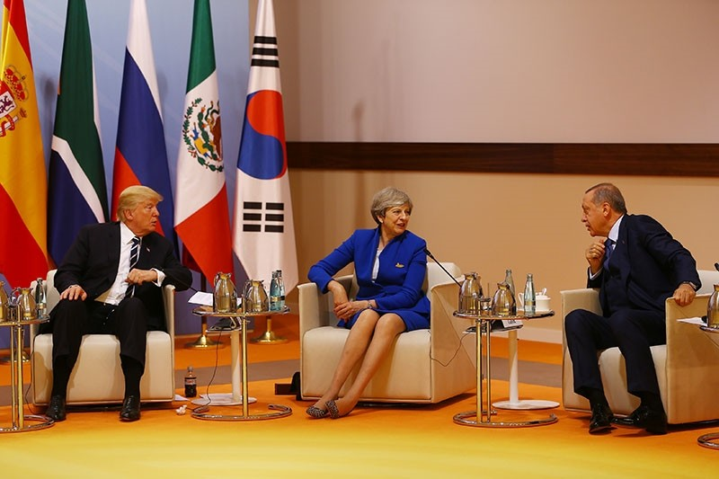 President Recep Tayyip Erdou011fan, U.S. President Donald Trump (L) and the U.K. Prime Minister Theresa May (C) seen during a counter-terrorism related session at the G20 summit in Hamburg on Friday. July 7, 2017. (AA Photo)