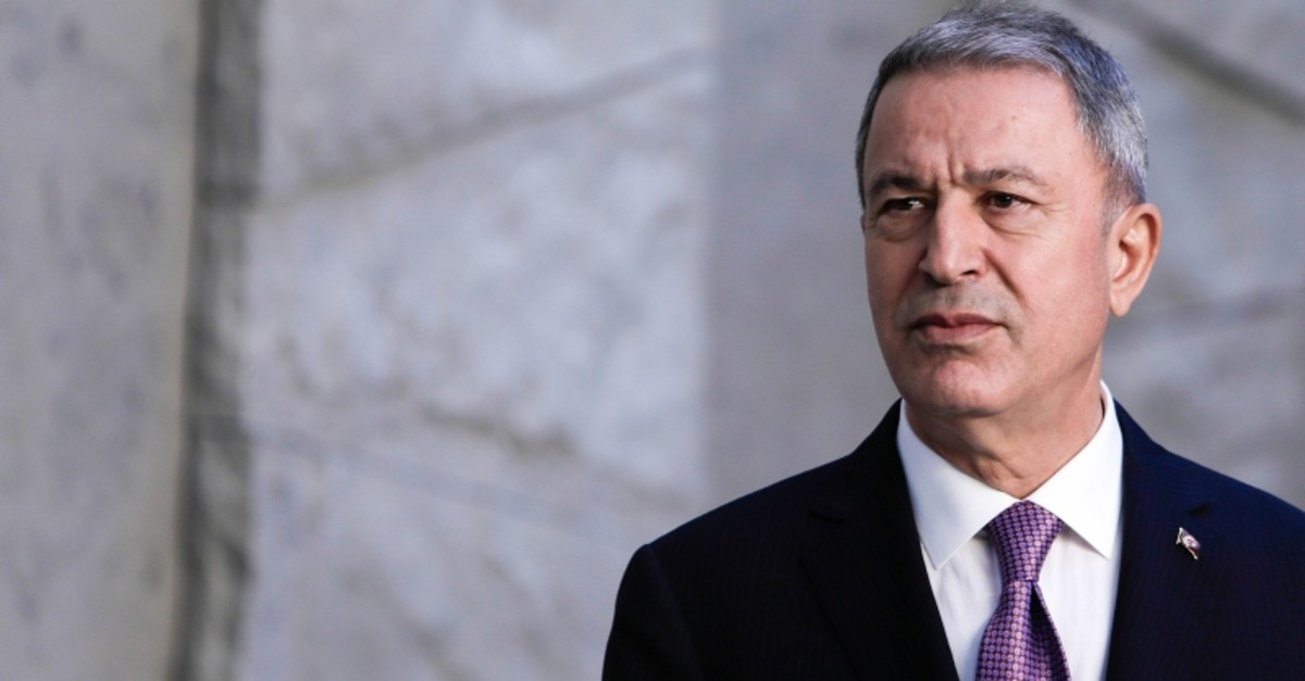 Defense Minister Hulusi Akar looks on before posing for a family picture during the NATO Defense Ministers meeting in Brussels on June 27, 2019. (AFP Photo)