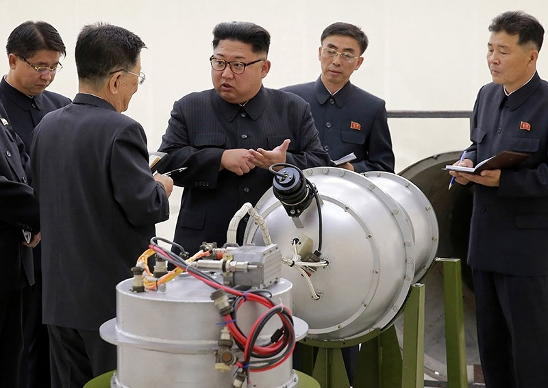 This undated file photo distributed by the North Korean government shows North Korean leader Kim Jong Un, center, at an undisclosed location in North Korea. (AP Photo)