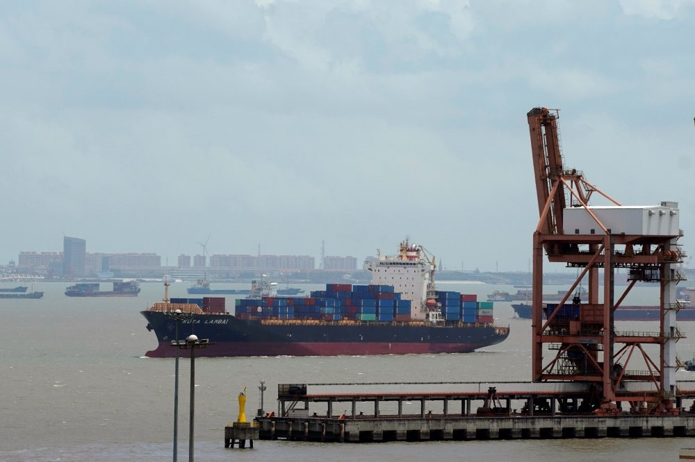 Shipping containers are seen at a port in Shanghai, China, July 10.