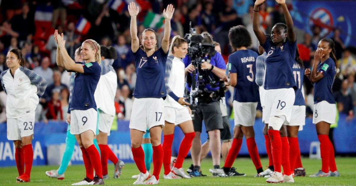 France's Eugenie Le Sommer, Gaetane Thiney and Griedge Mbock Bathy celebrate victory against Nigeria, June 17, 2019.
