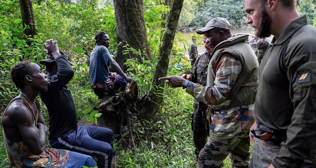 Members of the 9th Marine Infantry Regiment ust caught three illegal gold panners on a path in the jungle as part of the Harpie Operation conducted by French Guiana Armed Forces and gendarmes to fight illegal gold panning in French Guiana, Jan. 20.