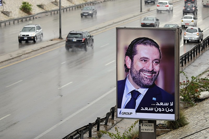 A poster bearing a portrait of Lebanese Prime Minister Saad Hariri reads in Arabic ,There is no hapiness without Saad, is seen on a billboard on Beirut's airport highway, on November 21, 2017 (AFP Photo)