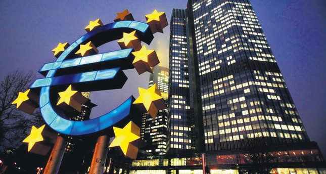 A sculpture in the shape of a euro sign seen in front of the European Central Bank headquarters in Frankfurt, Germany, Feb. 3, 2010.