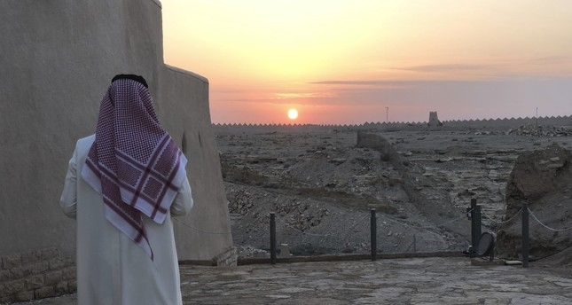 A Saudi man watches the sun setting over Dhiriyah, Riyadh, Saudi Arabia, Dec. 16.