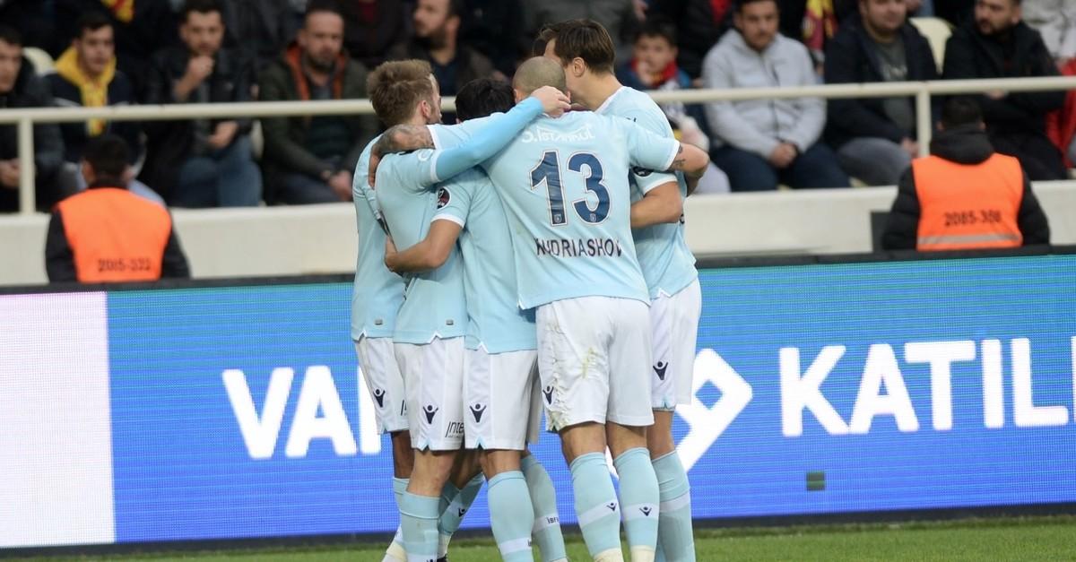 Bau015faku015fehir players cheer their win against Malatyaspor where Edin Visca (R) score one goal.
