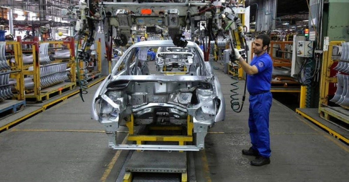 An Iranian worker assembles a car at the Iran Khodro automobile manufacturing plant, just outside Tehran, Iran, Jan. 18, 2014. (AP Photo)