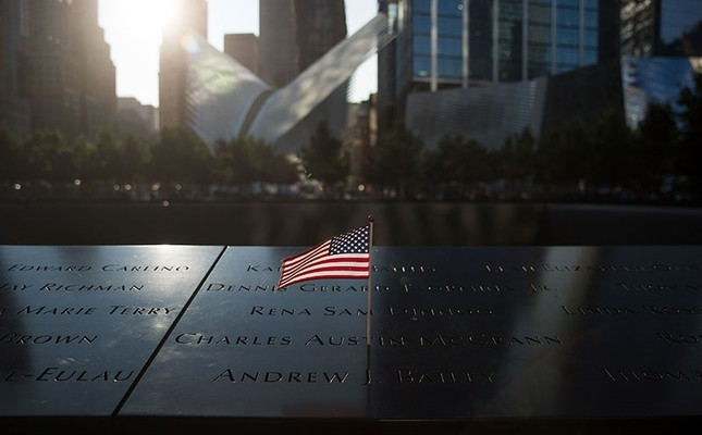 An American flag is left at the North pool memorial site before a commemoration ceremony for the victims of the September 11 terrorist attacks at the National September 11 Memorial, September 11, 2017 in New York City. (AFP Photo)