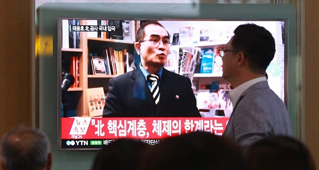 In this Wednesday, Aug. 17, 2016 file photo, people watch a TV news program showing a file image of Thae Yong Ho, a minister at the North Korean Embassy in London, at Seoul Railway Station in Seoul, South Korea. (AP Photo)