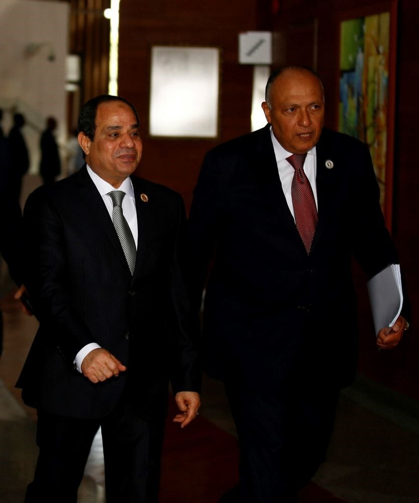 Egypt's President Abdel Fattah el-Sissi and his Foreign Minister Sameh Shukri arrive at the 28th Ordinary Session of the Assembly of the Heads of State and the Government of the African Union in Ethiopia's capital Addis Ababa, Jan. 31. (Reuters)