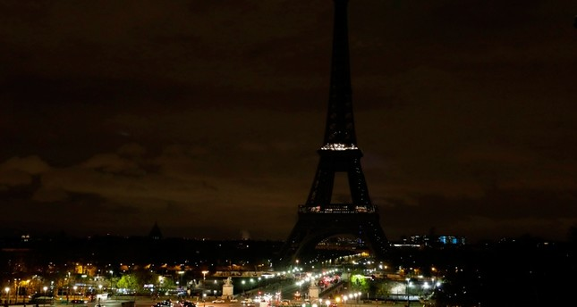 The lights of the Eiffel Tower in Paris are switched off on November 24, 2017 in tribute to the victims of the deadly attack on a mosque in Egypt's Sinai ( AFP Photo)