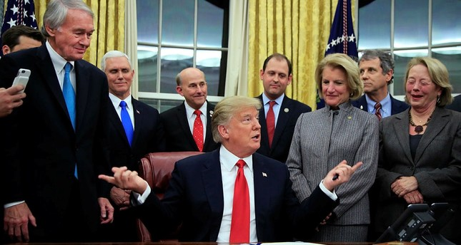 President Donald Trump speaks after signing into law the bipartisan Interdict Act, during a ceremony in the Oval Office of the White House in Washington, Wednesday, Jan. 10, 2018. (AP Photo)