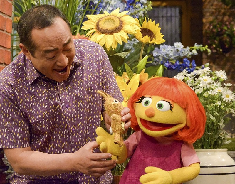 This image released by Sesame Workshop shows Julia, a new autistic muppet character debuting on the 47th Season of ,Sesame Street,, on April 10, 2017. (AP Photo)