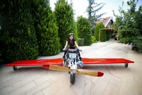 Inventor ready to takeoff with homemade flying motorbike