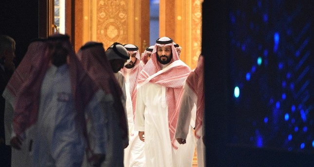 Saudi Crown Prince Mohammed bin Salman (C) arrives to attend a session during the Future Investment Initiative conference, Riyadh, Oct. 24.