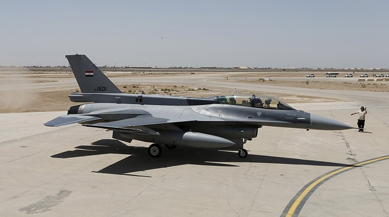 Iraqu2019s Defence Minister Khaled al-Obeidi (left) sits in a F-16 fighter jet, during an official ceremony to receive four of these aircrafts from the US at a military base in Balad, Iraq, July 20, 2015. (Reuters Photo)