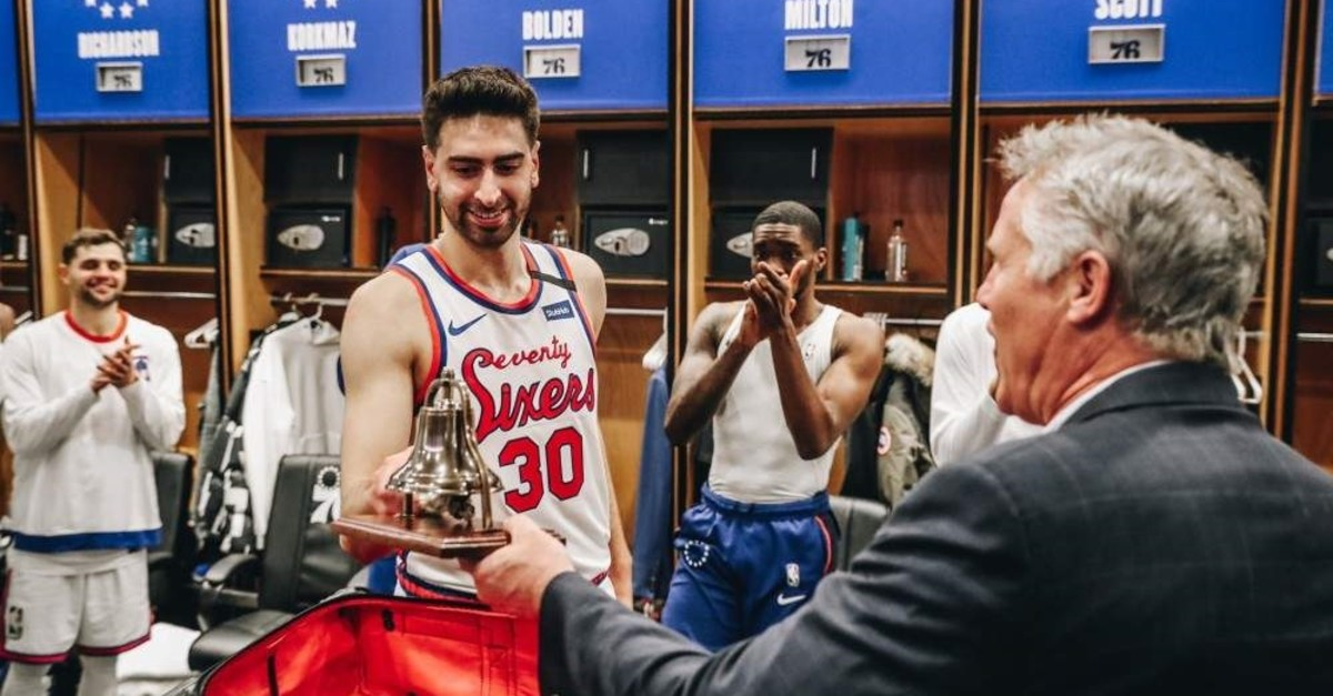 Philadelphia 76ers' Furkan Korkmaz presented an award after strong performance against Chicago as teammates celebrate, on Jan 17, 2020. (DHA Photo)