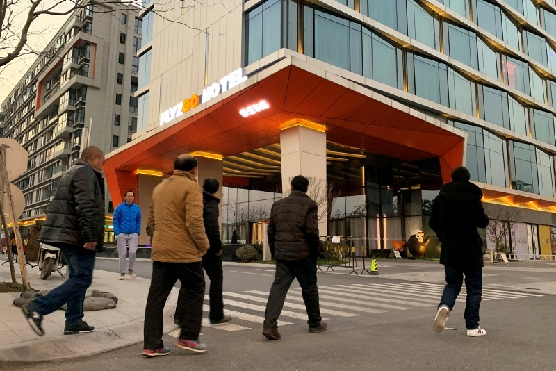 Men walk past Alibaba Group's futuristic FlyZoo hotel in Hangzhou, Zhejiang province, China Jan. 22, 2019 (Reuters Photo)