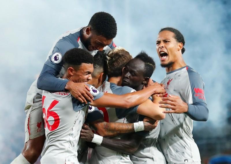 Liverpool's Sadio Mane celebrates scoring their second goal with team mates. (REUTERS Photo)