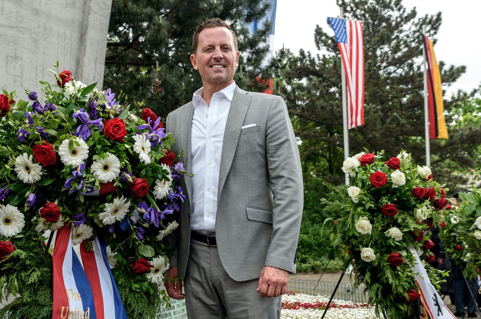 U.S. ambassador to Germany Richard A. Grenell stands beside a wreath in Berlin, May 12.