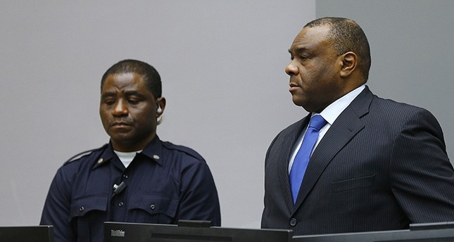 ean-Pierre Bemba takes his seat in the court room of the International Criminal Court in The Hague, Netherlands, Tuesday, June 21, 2016 (AP Photo)