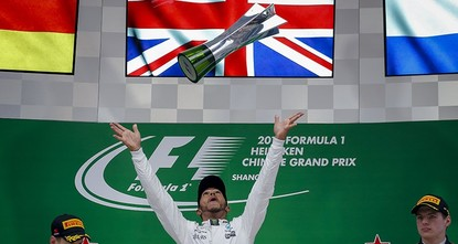 pLewis Hamilton of Mercedes took a comfortable first win of the Formula One season in Sunday's Chinese Grand Prix while Sebastian Vettel and Max Verstappen won the battle of the chasing pack to...