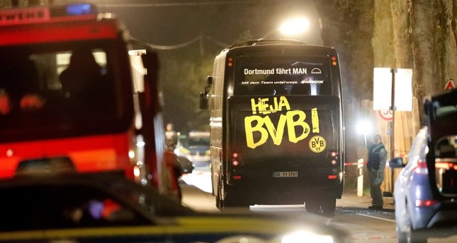 The team bus of German club Borussia Dortmund is seen surrounded by police and emergency vehicles on a street after it was hit by three explosions in Dortmund on April 1.