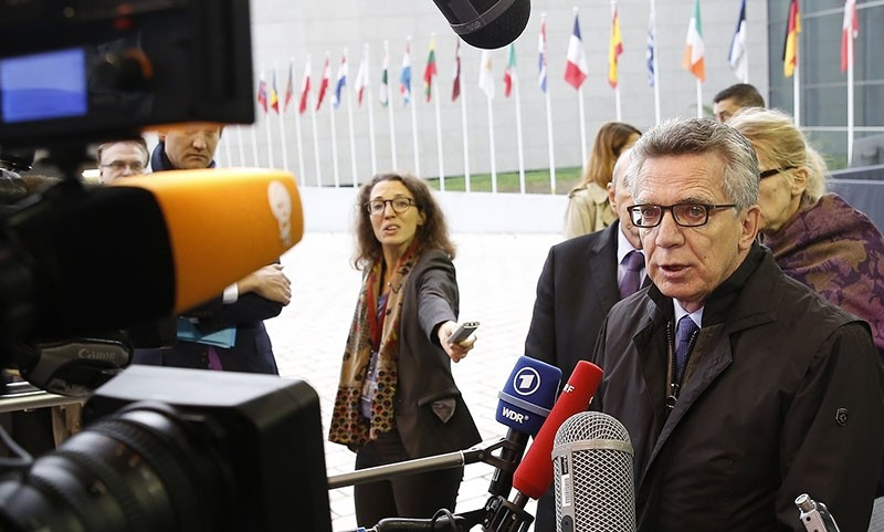 German Interior Minister Thomas de Maiziere speaks to media at the start of the Joint Justice and Home Affairs Council meeting in Luxembourg, 13 October 2017 (EPA Photo)