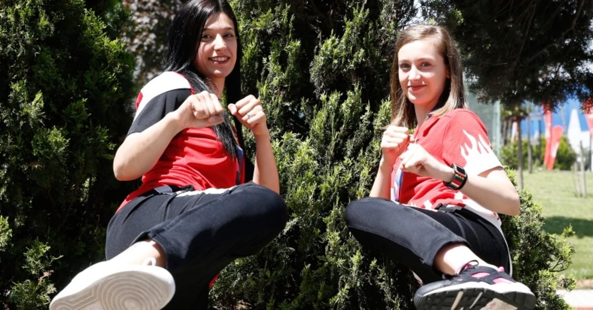Turkey's national taekwondo fighters Nur Tatar Askari, left, and Zeliha Au011fru0131s pose for a photograph. (AA Photo)
