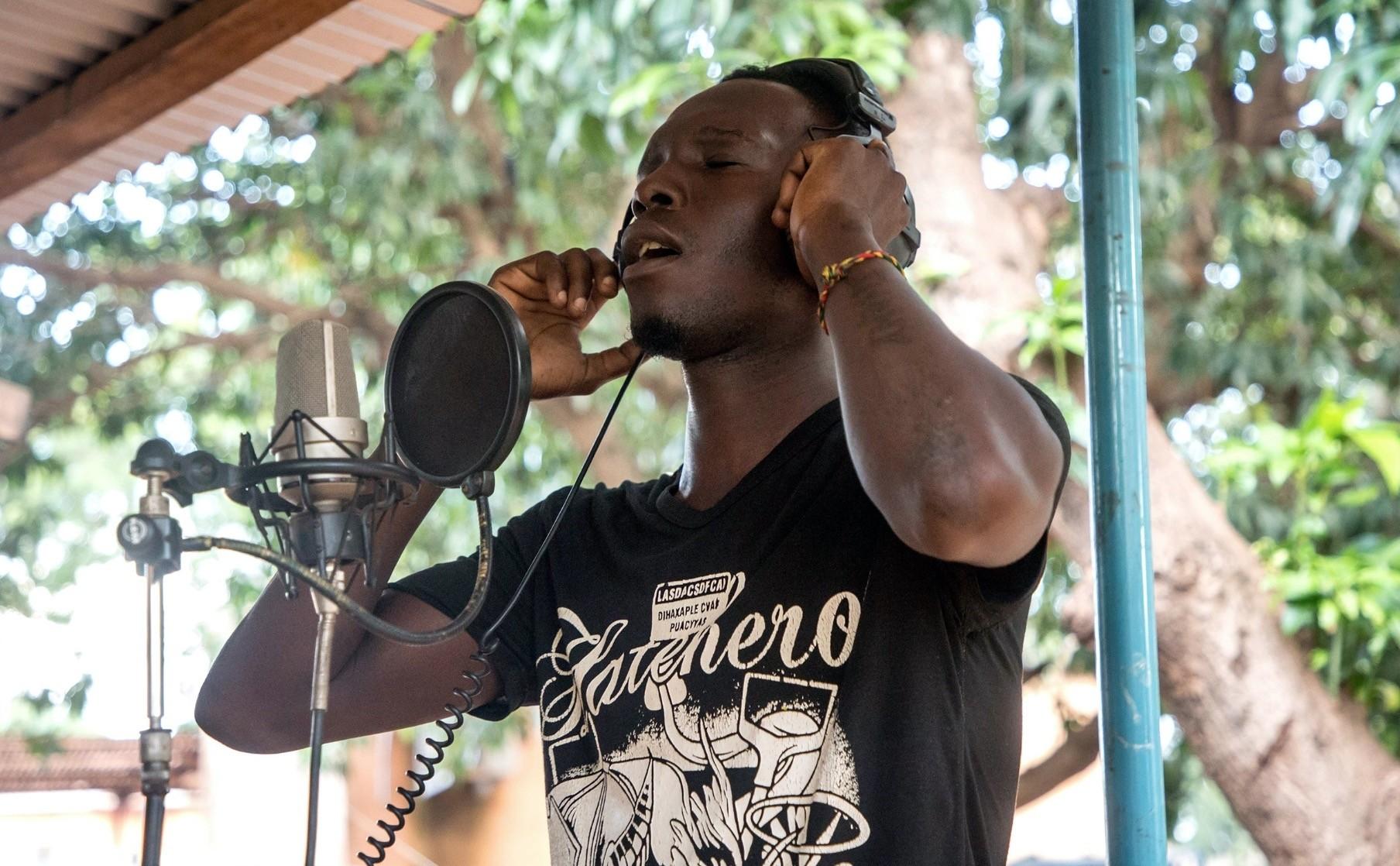 Jonathan Sougue, records his album at the Bobo Dioulasso prison.