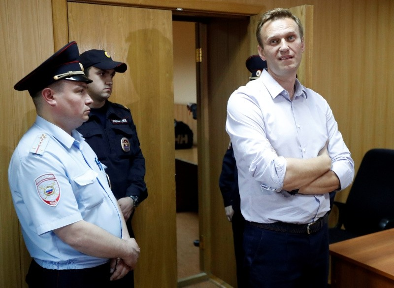 Russian protest leader Alexei Navalny, right, who organized a series of protests on May 5 2018 in the Russian capital, stands in the court in Moscow, Russia, Tuesday, May 15, 2018. (AP Photo)