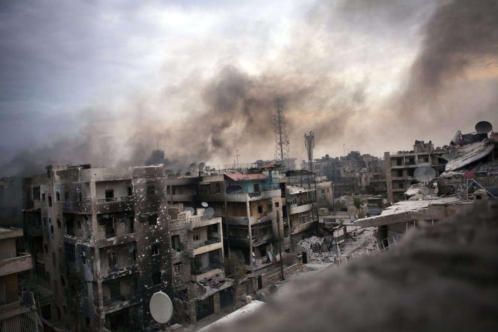 Smoke billows over shelled and destroyed buildings in Saif al-Dawle district, Aleppo, Oct. 2, 2016.