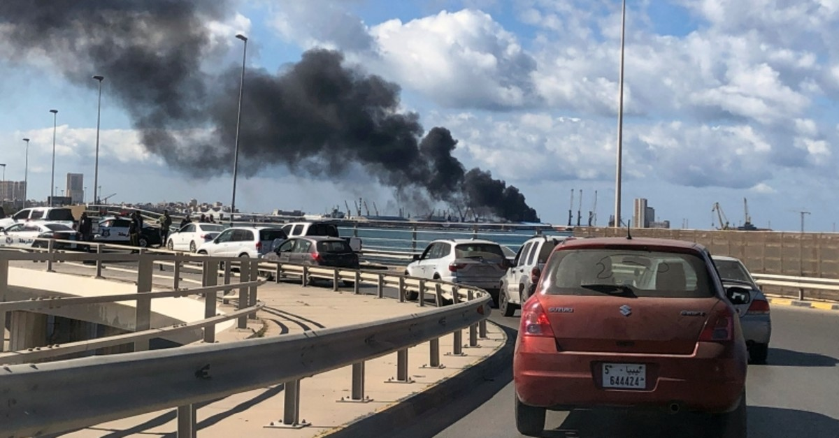 A smoke rises from a port of Tripoli after being attacked in Tripoli, Libya February 18, 2020. (Reuters Photo)