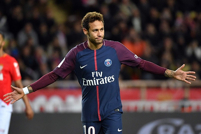 Paris Saint-Germain's Brazilian forward Neymar celebrates after scoring a penalty kick during the French L1 football match between Monaco and PSG at the Louis II stadium, in Monaco, Nov. 26, 2017. (AFP Photo)