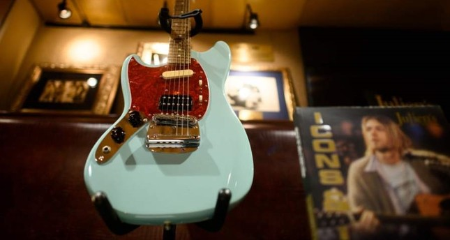 Kurt Cobain's custom-built left-handed Fender Mustang guitar that he used during Nirvana's In Utero tour is on display at the Hard Rock Cafe in New York City ahead of the auction of Julien's Auctions on October 21, 2019 in New York City. (AFP Photo)