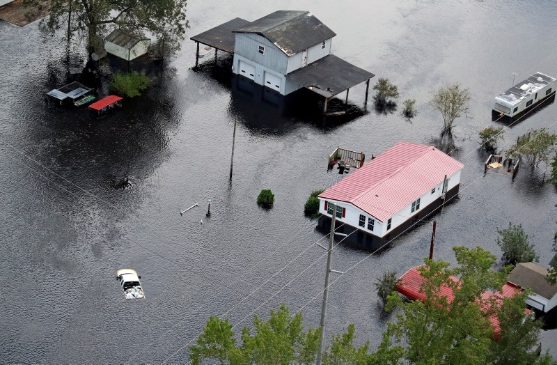 Houses sit in floodwater caused by Hurricane Florence, in this aerial picture, near Lumberton, North Carolina, U.S. September 17, 2018. (Reuters Photo)