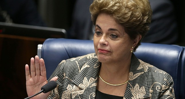 Suspended Brazilian President Dilma Rousseff waves goodbye after her impeachment trial at the Federal Senate in Brasilia, Brazil, Monday, Aug. 29, 2016. (AP Photo)
