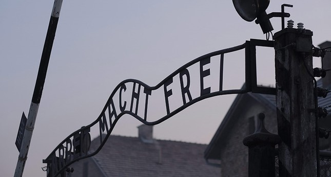 A sign reads 'Work sets you free', on the gate of the former Nazi-German concentration and death camp KL Auschwitz-Birkenau in Oswiecim, Poland, 27 January 2017. (EPA Photo)