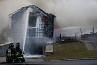Gas blasts in dozens of Boston homes kill 1, injure 10